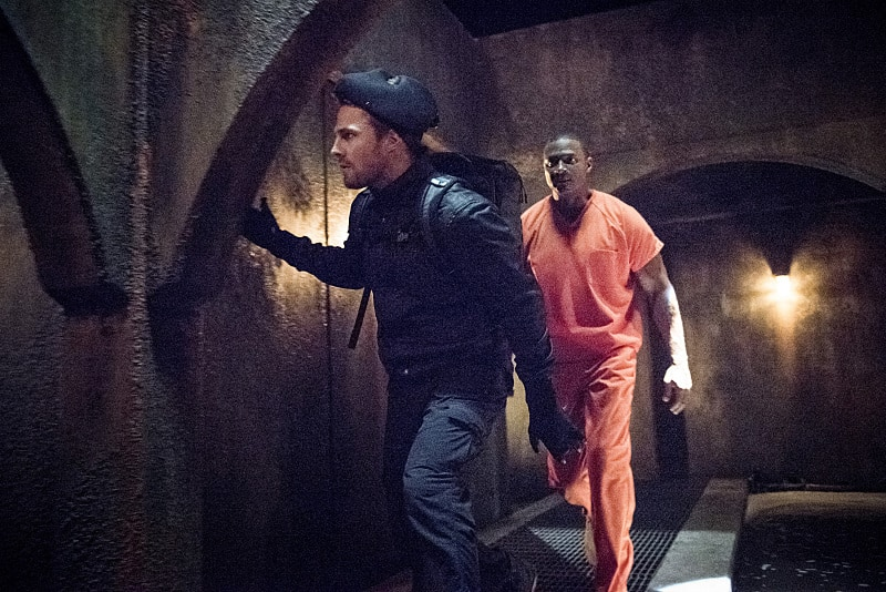 "Arrow -- ""Penance"" -- Image AR504b_0170b.jpg -- Pictured (L-R): Stephen Amell as Oliver Queen and David Ramsey as John Diggle -- Photo: Dean Buscher/The CW -- © 2016 The CW Network, LLC. All Rights Reserved."