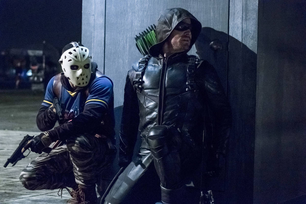 """Arrow -- """"Second Chances"""" -- Image AR511b_0401b.jpg -- Pictured (L-R): Rick Gonzales as Rene Ramirez/Wild Dog and Stephen Amell as Green Arrow -- Photo: Katie Yu/The CW -- © 2017 The CW Network, LLC. All Rights Reserved."""