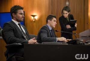 "Arrow -- ""Fighting Fire With Fire"" -- Image AR515b_0019b.jpg -- Pictured (L-R): Stephen Amell as Oliver Queen, Josh Segarra as Adrian Chase, and Willa Holland as Thea Queen -- Photo: Diyah Pera/The CW -- © 2017 The CW Network, LLC. All Rights Reserved."