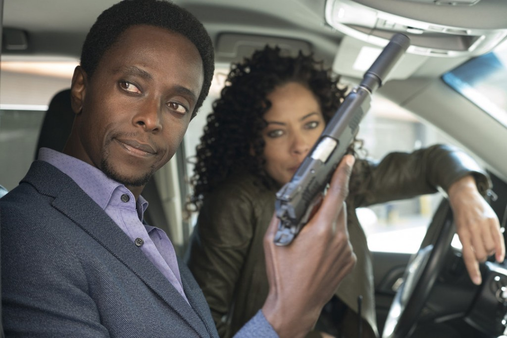 "THE BLACKLIST: REDEMPTION -- ""Whitehall"" Episode 107 -- Pictured: (l-r) Edi Gathegi as Matias Solomon, Tawny Cypress as Nez Rowan -- (Photo by: Virginia Sherwood/NBC)"