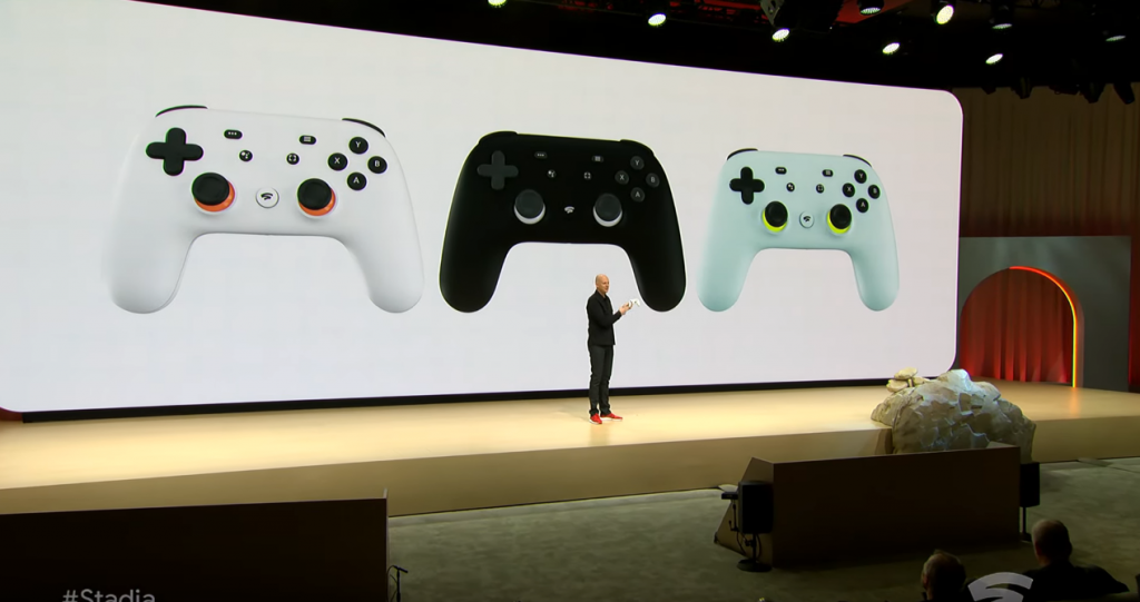 Three different colored Stadia controllers.